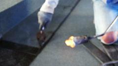 Bitumen roofing, asphalt installation with fire Stock Footage