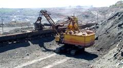 Mining dump trucks in the open pit mine Stock Footage