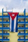 Cuban flag over hotel balconies Stock Photos