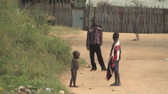 Naked Child with Family in SOUTH SUDAN, AFRICA Stock Footage