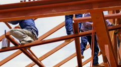 Metal structure workers on the beam Stock Footage