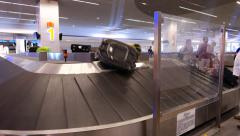 Passenger bags delivered, baggage carousel loaded by luggage Stock Footage