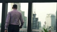 Successful businessman on roof looking at cityscape, super slow motion,  HD Stock Footage