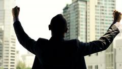 Successful businessman raising arms, power symbol, super slow motion, 240fps HD Stock Footage