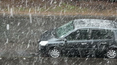 Heavy snowfall on the residential street - snow-covered car Stock Footage