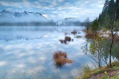 Blue sky in misty morning on Barmsee in Alps Stock Photos