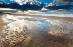 low tide at sunset on North sea - stock photo