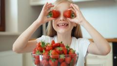 Closeup portrait of a girl with strawberry eyes Stock Footage