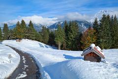 Alpine road in snow winter - stock photo
