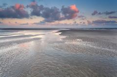 Low tide on North sea during sunrise Stock Photos