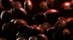 Slow motion drop roasted coffee beans - repeatly move Stock Footage