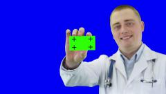 Doctor demonstrates a business card. Chroma key background - stock footage
