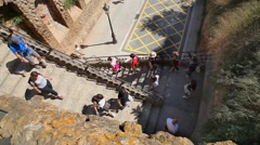 Tourists take the stairs down to the garden at the museum in Barcelona, Spain Stock Footage