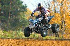 Nice jump with quad motorbike - stock photo