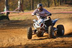 ATV motorbike rider in the race Stock Photos