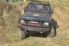 Black SUV at difficult terrain - stock photo