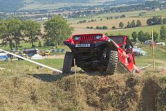Red SUV at difficult terrain Stock Photos