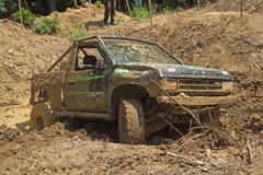 Recovering the vehicle from the muddy terrain - stock photo