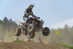 Quad racer with camera on helmet is jumping - stock photo