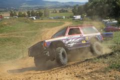 SUV car is passing through difficult terrain skid - stock photo