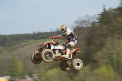Dynamic shot of Quad racer jumping Stock Photos