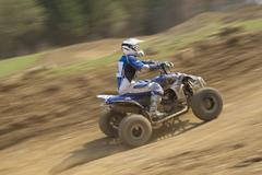 Quad rider. All trademarks are removed. - stock photo