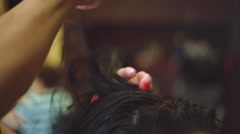 Close-up of Hairstylist's hand cutting hair Stock Footage