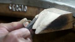 Goldsmith or silversmith smoothing and finishing a ring with the file Stock Footage