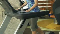Woman running on treadmill machine in gym HD Stock Footage
