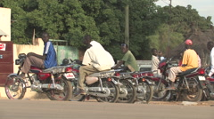 BIKERS PARK AND TALK ON THE SIDE OF THE ROAD IN SOUTH SUDAN, AFRICA Stock Footage