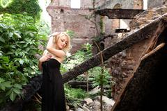 Beautiful and feminine pose of a refined and elegant blonde woman Stock Photos