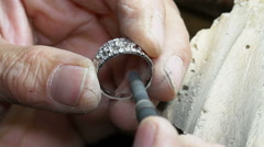 Goldsmith smoothing a ring with a polishing machine - stock footage