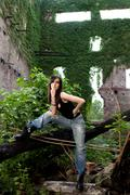 Lovely brunette in a deserted building with a ready to conquer attitude. - stock photo