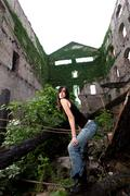 Lovely brunette with a rockier attitude posing in a deserted building. - stock photo