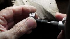 Goldsmith: polish a ring with a polishing brush Stock Footage