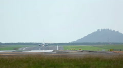 Airplane taking off and birds over runway Stock Footage