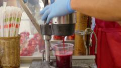 Street food scene. Squeezing fresh pomegranate juice. Stock Footage