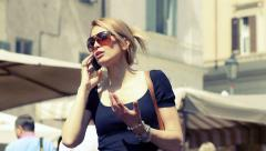 Young cute woman having a phone call in Campo de Fiori in Rome Stock Footage
