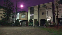 Night Time Bright Moon Over Tokyo Residential Neighborhood Stock Footage