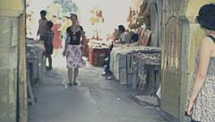 Tunisia 1980s: tourists walking in a bazar Stock Footage