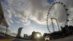 Timelapse of Singapore Flyer with Marina Bay Sands in Background Stock Footage