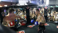 Boxing cage muay thai fighters Stock Footage