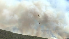 Cape Town-March,2015:Helicopter filling water bucket for aerial fire fighting - stock footage