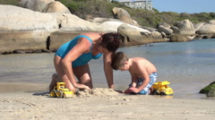 Mother and child playing on beach with toys,Boulders Beach,Cape Town,South Stock Footage