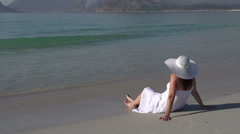 Woman sitting on beach looking out to see, Cape Town,South Africa Stock Footage