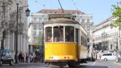 Vintage yellow tram in the center of Lisbon, Portugal Stock Footage