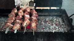 Pieces of roasted shashlik beef meat on grill. Street food. - stock footage