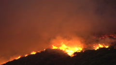 Stock Video Footage of Cape Town-March,2015: Fierce bush fires endanger property on the slopes of Table