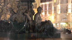 Rossio square fountain by city lights Stock Footage