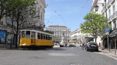 Losbon yellow tram in the city center Stock Footage